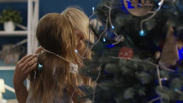 Thumbnail for Content Woman with Little Girl Decorating Christmas Tree