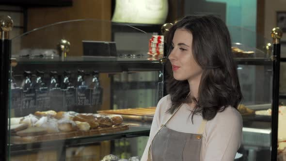 Charming Female Baker Smiling To the Camera at Her Bakery Store
