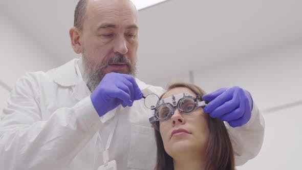 Thumbnail for Senior Optician Testing Eyesight of Female Patient