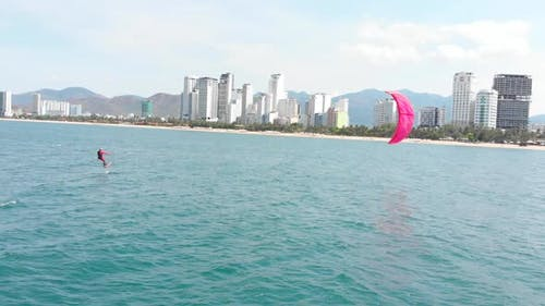 Healthy Lifestyle, Human Flight, Kite Surfing Place, Sports Concept, Aerial View of the City Beach
