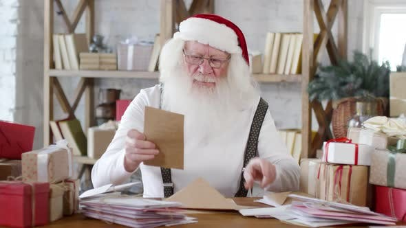 Thumbnail for Cheerful Santa Reading Letter and Laughing