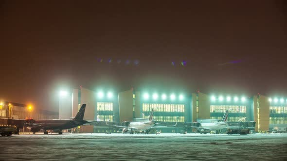 Thumbnail for Timelapse Shot of Sheremetyevo Airport Routine at Winter Night, Moscow