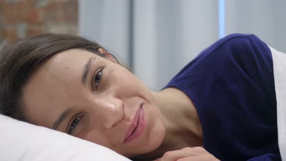 Thumbnail for Online Video Chat in Bed by Happy Hispanic Woman