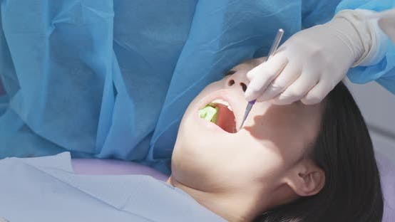 Thumbnail for Woman undergo dental check up at dental clinic