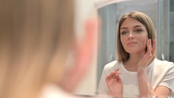 Thumbnail for Rear View of Beautiful Woman Doing Face Massage in Mirror