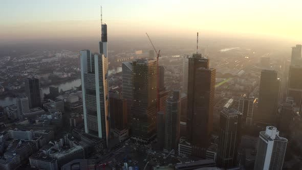 AERIAL: View of Frankfurt Am Main, Germany Skyline with Sunflair Between Skyscrapers in Beautiful