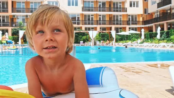 Thumbnail for Happy Little Boy Sitting near the Pool
