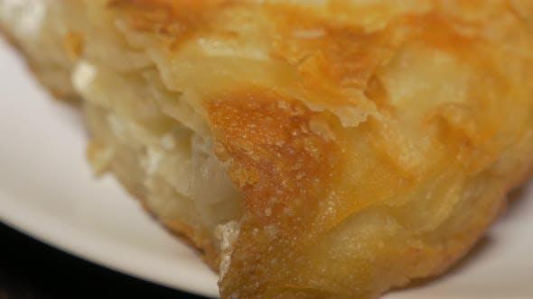 Burek fast food made in Serbia close-up 4K 2160p UHD video - Burek traditional  breakfast meal in Se