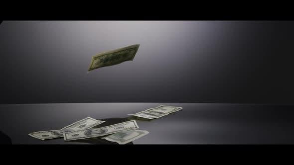American $100 Bills Falling onto a Reflective Surface - MONEY 0005