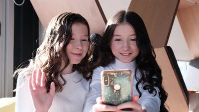 Two fun beautiful sisters take selfie photos
