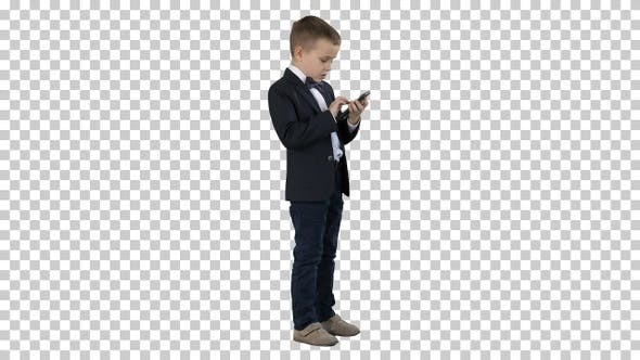Young boy in elegance suit playing with mobile phone, Alpha Channel