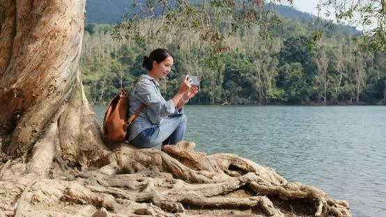 Thumbnail for Woman enjoy view of the lake