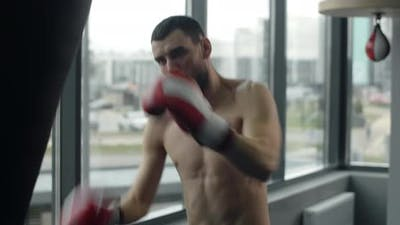 Kickboxer Punches Boxer Bag By His Arms and Legs in Slow Motion at Training Training at the