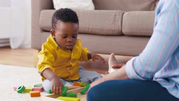 Thumbnail for Mother and Baby Playing with Toy Blocks at Home 16