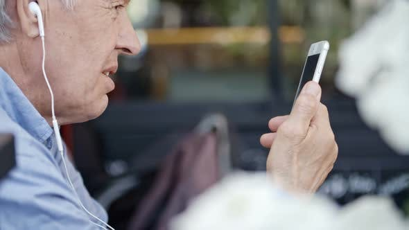 Cover Image for Elderly Man Video Calling on Smartphone