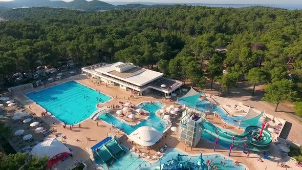 Thumbnail for Aerial view above of aquapark full of people, Mali Losinj, Croatia.