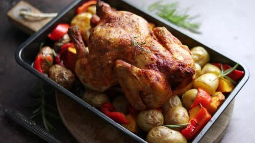 Delicious Whole Chicken Cooked with Pumpkin, Pepper and Potatoes. Served in Metal Baking Pan.