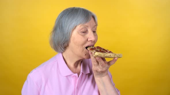 Cover Image for Senior Woman Eating Pizza