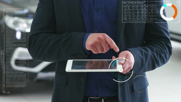 Concept of the Visual Future. A Man Shows on the Tablet a Pound Sterling Sign and Futuristic