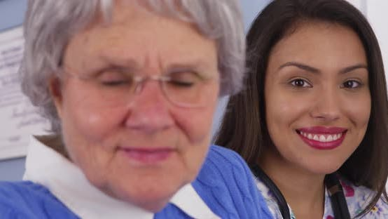 Thumbnail for Happy elderly patient smiling with Mexican caregiver