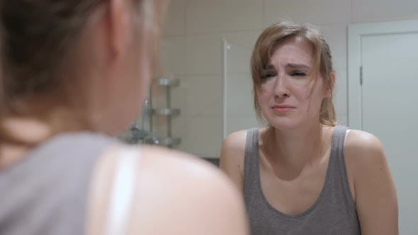 Thumbnail for Crying Woman in Mirror Looking at Herself, Weeping