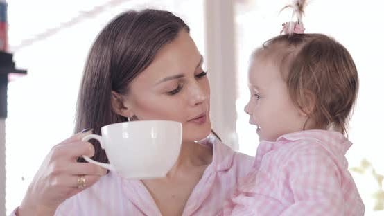 Thumbnail for Mother with Daughter Standing at Kitchen and Drinking Coffee