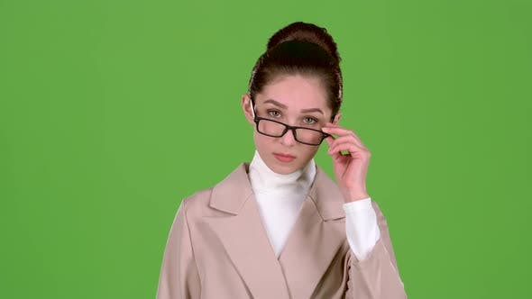 Thumbnail for Businesswoman Corrects Glasses and Is Angry with Her Subordinates. Green Screen. Slow Motion