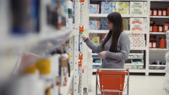 Thumbnail for Young Women Selecting Detergents for House at Supermarket