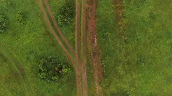 Aerial Flight Over Muddy Road