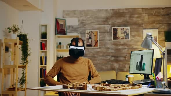 Young Architect Using Virtual Reality Goggles