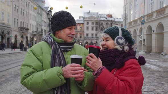 Thumbnail for Senior Old Couple Tourists Grandmother Grandfather Traveling Drinking Hot Drink Tea in City Center