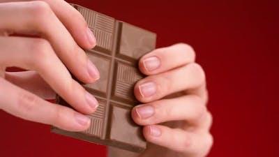 Man breaking chocolate