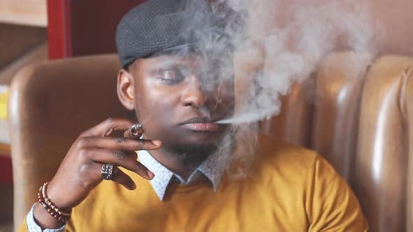 Thumbnail for Black man smoking cigar portrait with hat