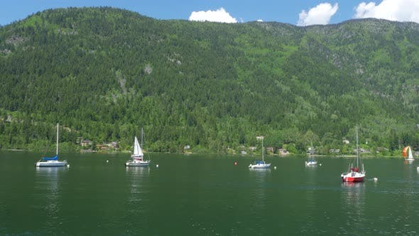 Thumbnail for Pan Across Beautiful Kootenay Lake In Nelson In The Summer With Sail Boats 01