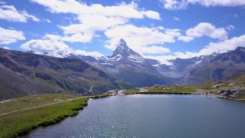Aerial travel drone view of Zermatt at the Stellisee Lake, Mount Matterhorn, Switzerland.