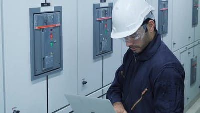Worker in electrical control room