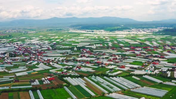 Thumbnail for Drone Flies Above Village with Greenhouses