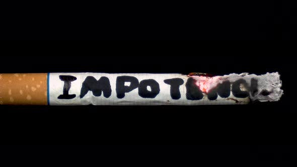 "Thumbnail for A Cigarette Smolders with the Word ""Impotence"". Cigarette on a Black Isolated Background"