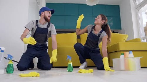 Happy Young People of the Cleaning Company Giving High Five