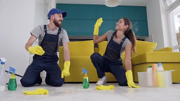Thumbnail for Happy Young People of the Cleaning Company Giving High Five