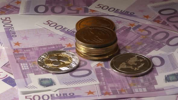 Thumbnail for Ripple Coins Rotating on Bills of 500 Euro Banknotes. Worldwide Virtual Internet Cryptocurrency.