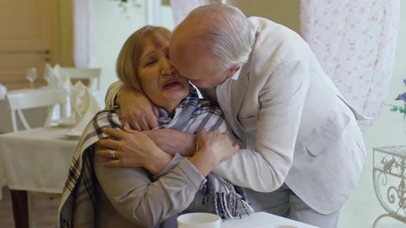 Thumbnail for Senior Man Giving Plaid to Elderly Wife