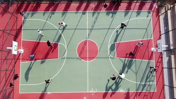 Men Play Streetball at Outdoor Court Aerial View