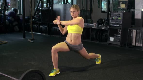 Thumbnail for A woman stretching at the gym