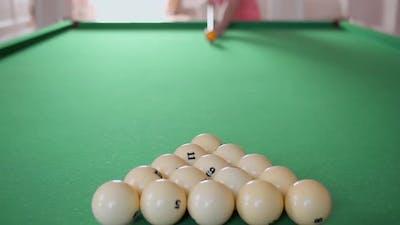 Man plays billiards, rack focus