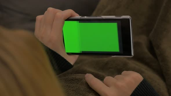 Thumbnail for Changing content mobile phone green screen display 4K 2160p UHD video - Woman holding smart phone wi