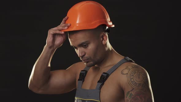 Thumbnail for Handsome Sexy Muscular Constructionist Smiling Wearing Hardhat