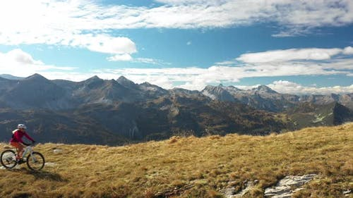 Aerial View Woman Mountain Biking on Ridge