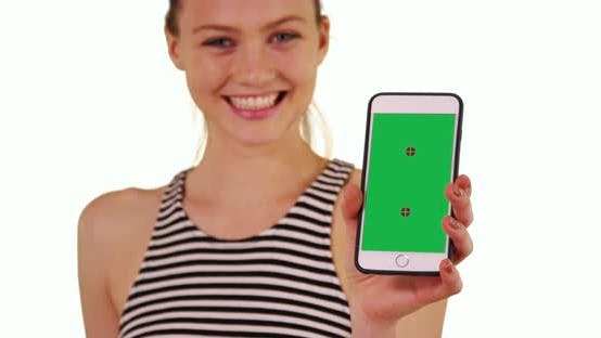 Thumbnail for Cheerful single blonde woman showing smartphone with Chroma key