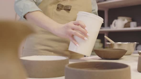 Potter Painting Crockery in Ceramic Workshop